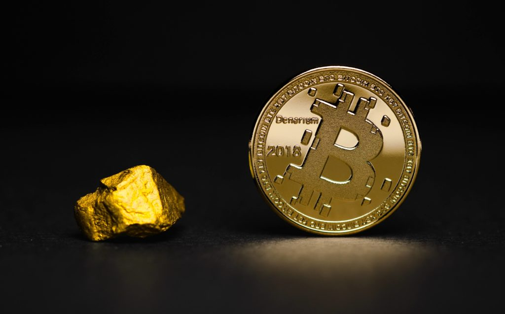 "Bitcoin ""coin"" and a chunk of gold"