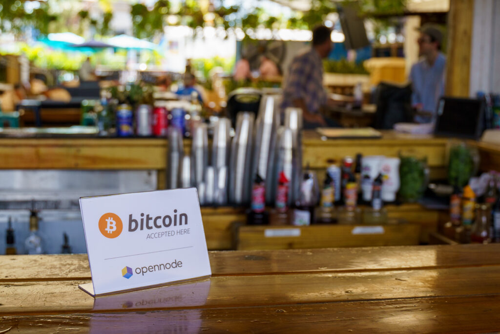 Image of Bitcoin accepted here sign at the Bitcoin 2021 conference.
